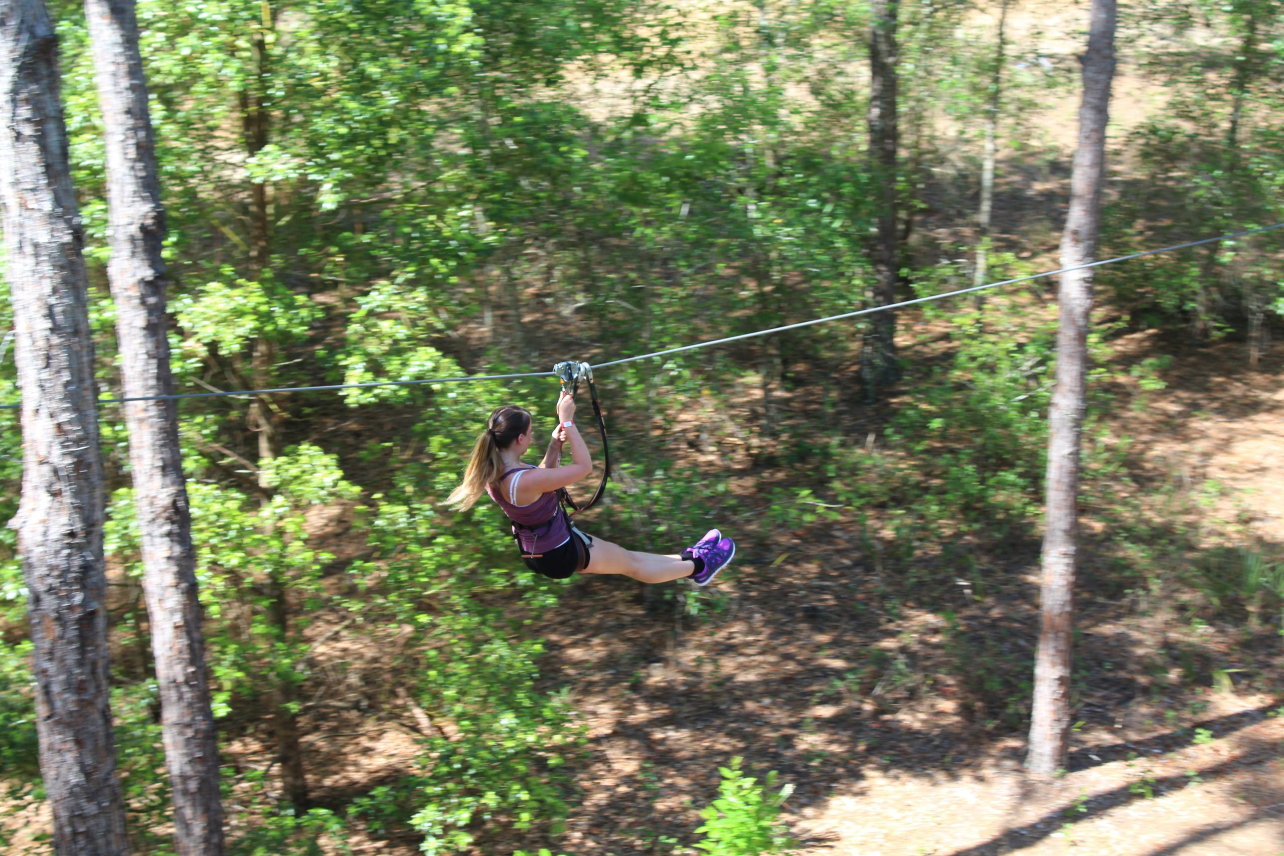 A guest is scene zip lining in Florida.