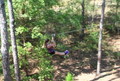 Woman ziplining at Orlando Tree Trek