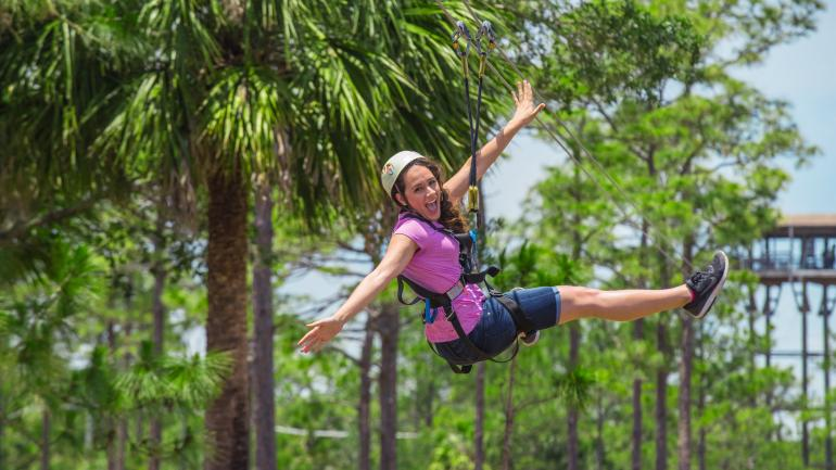 Woman ziplining at Orlando Tree Trek