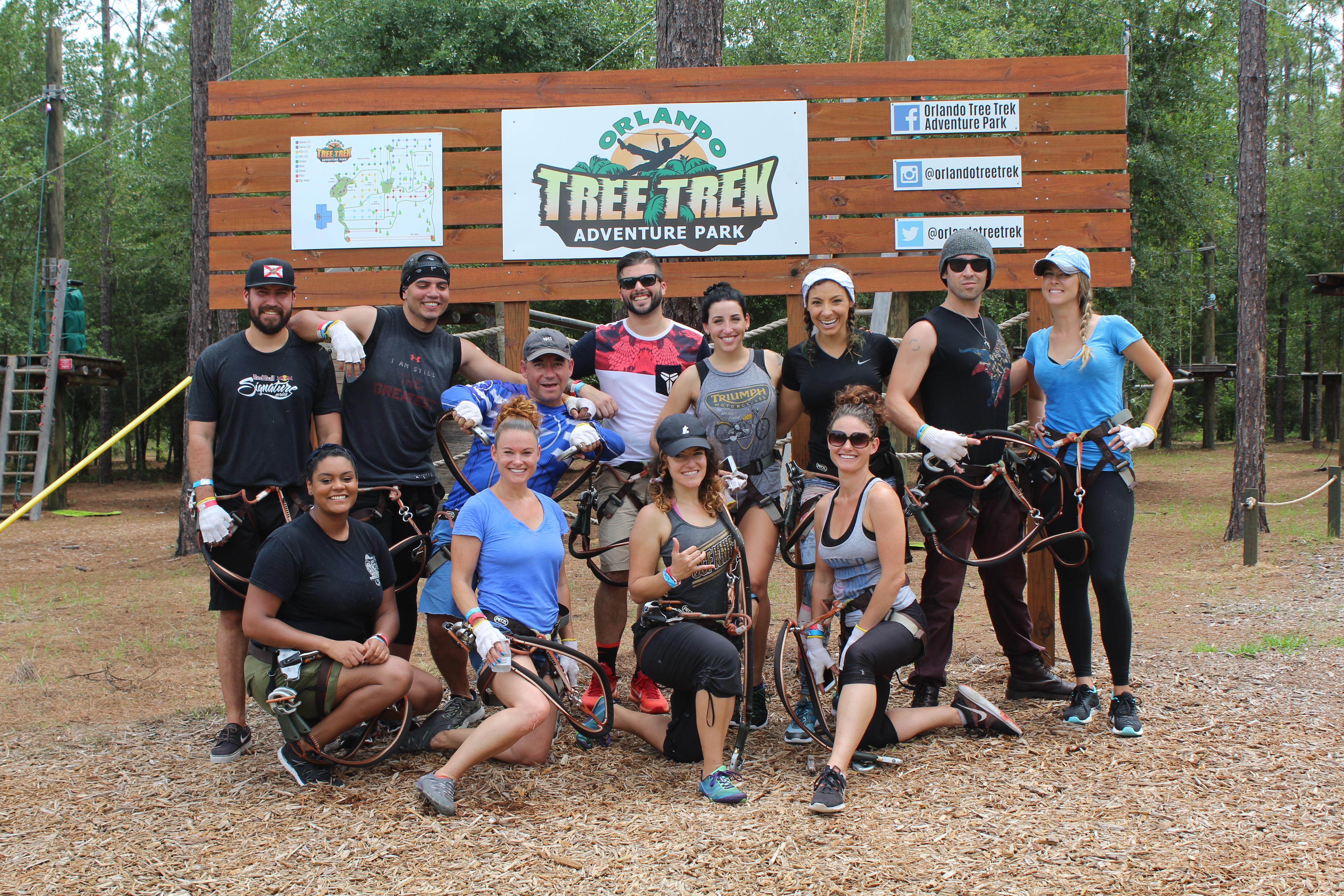 people in front of Orlando Tree Trek sign